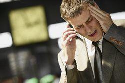 Unhappy man on phone