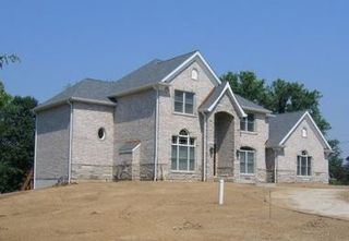 Mcmansion with few windows
