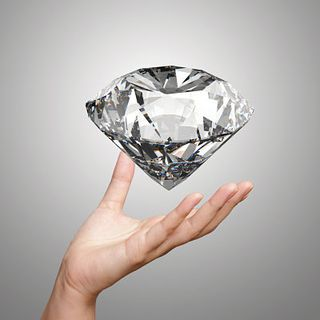 Bigstock-Hand-Holding-D-Diamond-Over-W-68180329_opt