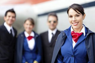 Flight attendant with cabin crew