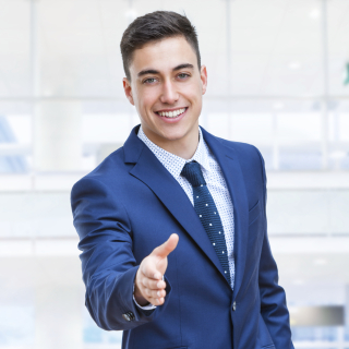 Businessman in suit reaching out hand